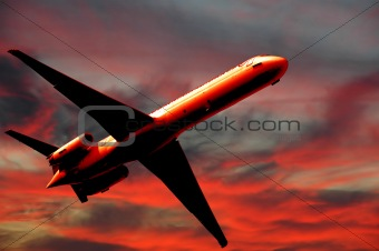 Air travel - plane and sunset