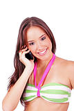 young smiling woman talking by phone on a white background