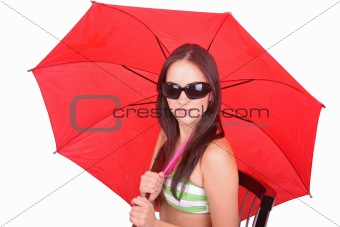 Portrait of young woman with a red umbrella on white background