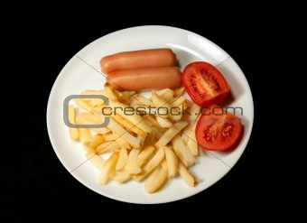 sausage served with french fries and tomatoes