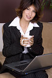 young business woman holding coffee cup