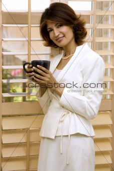 brunette holding cup of coffee