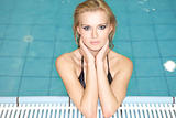 beautiful young woman standing in a swimming pool