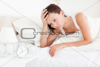 Tired red-haired woman waking up