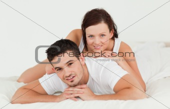 Beautiful Woman lying on her man