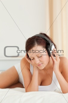 Close up of a Woman listening to music with closed eyes