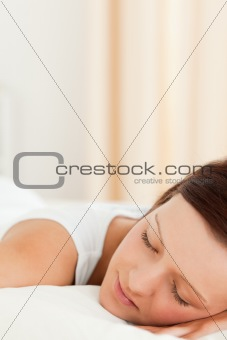 Close up of a cute Woman sleeping in her bed