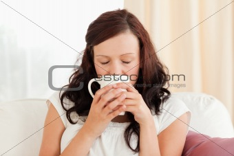 Portrait of a gorgeous woman drinking coffee