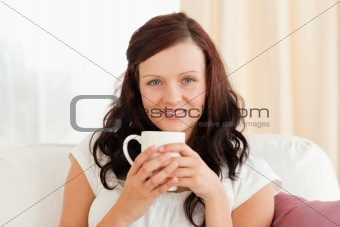 Cute woman holding a cup