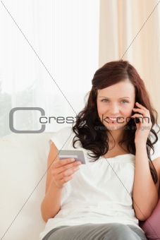 Attractive Woman on the phone holding credit card