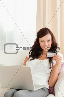 Woman doing online shopping looking at the camera