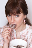 Portrait of a beautiful young brunette with tasty biscuits