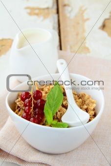 bowl of cornflakes with milk and  berries, healthy breakfast