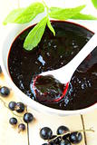 black currant  jam  with mint leaves