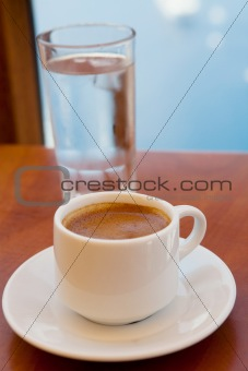 Greek coffee and a glass of water