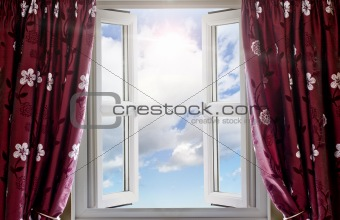 Modern window open with a view to sky and sun