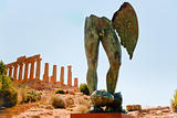 Temple of Juno and bronze statue in Valley of the Temples in Agrigento, Sicily