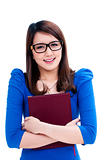 Happy female student in eyeglasses hugging her book
