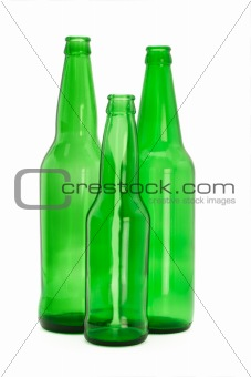 Three green glass bottles