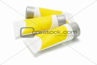 Three tubes with yellow labels
