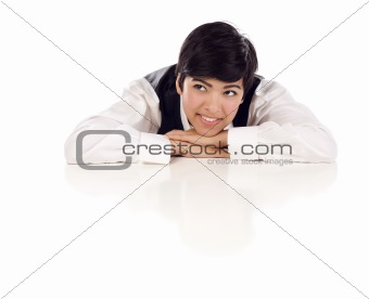 Attractive Smiling Mixed Race Young Adult Female Looking Up and Away Sitting At White Table Resting Her Head on Her Hands Isolated on a White Background.