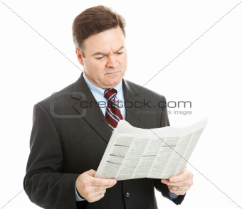Businessman Reading Bad News
