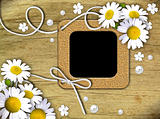 Vintage photo frames and white daisies