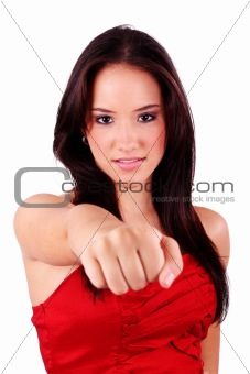Portrait of an attractive young female punching. Isolated on whi