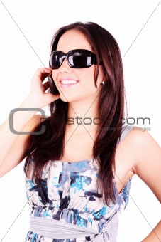 Attractive teenage girl talking on the phone. All on white backg