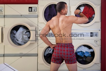 Half-naked Man in Laundromat