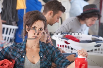 Serious Woman In Laundromat
