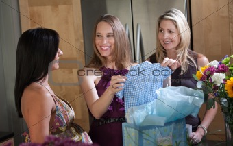 Expectant Mother Holding Baby Clothes