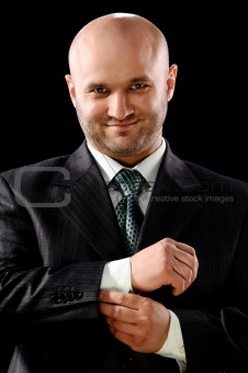 The businessman on a black background