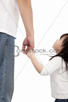 little girl looking her father and holding hand