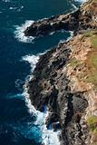 Rocky cliff on coast.
