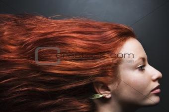Hair streaming behind woman.
