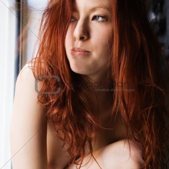 Topless redhead.