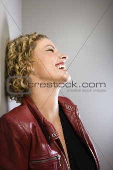 Blond woman laughing.