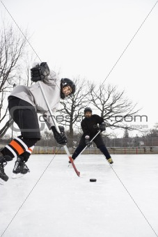 Boys playing ice hockey.
