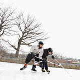 Boys playing winter sport.