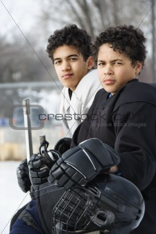 Boys in hockey uniforms.