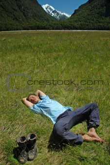 Young man resting on the grass