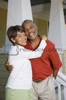 Happy couple hugging.