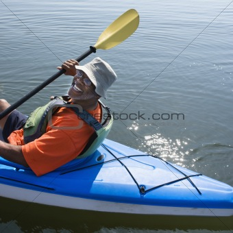 Happy man kayaking.