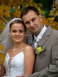Just married portrait in maple leaves