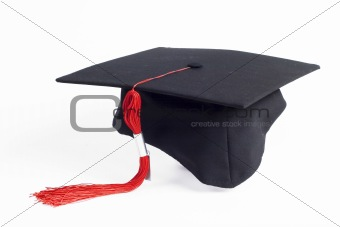 graduation cap with a red tassel