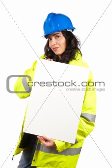 Female construction worker showing a blank banner