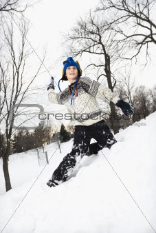 Boy throwing snow.