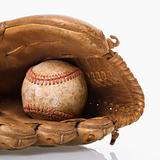 Baseball in glove.