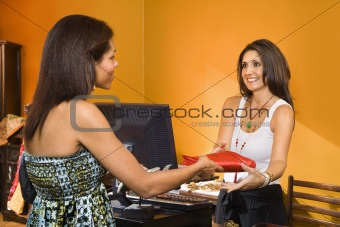 Woman making purchase.